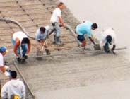 Construction Photo of Workers Pouring Concrete